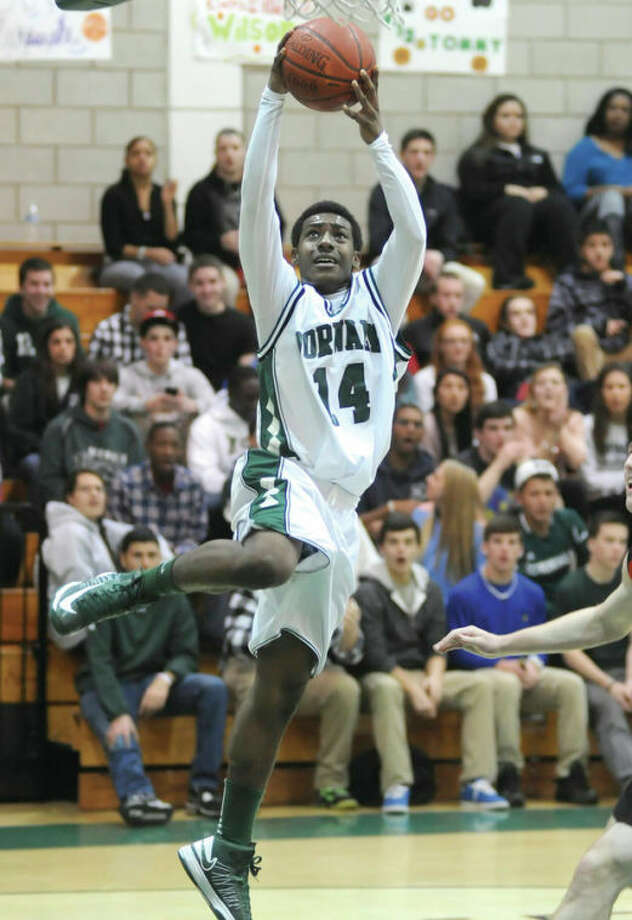 Hour photo/John NashNorwalk's Jabari Dear soars to the hoop for an easy two points on a fast-break layup during the second quarter of Friday's game in Norwalk. The Bears picked up a 61-47 victory in the clash between FCIAC playoff hopefuls.
