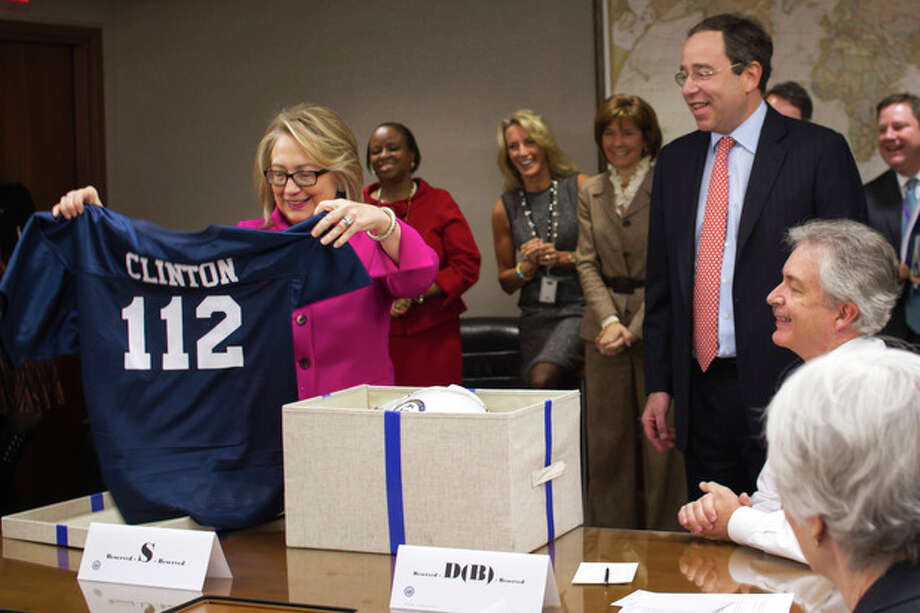 """AP photoThis photo provided by the State Department shows Secretary of State Hillary Rodham Clinton holding up a football jersey, number """"112""""; at the State Department in Washington, Monday. She was given the jersey with the number 112 to represent the record-breaking number of countries she has visited since becoming secretary of state . / State Department"""
