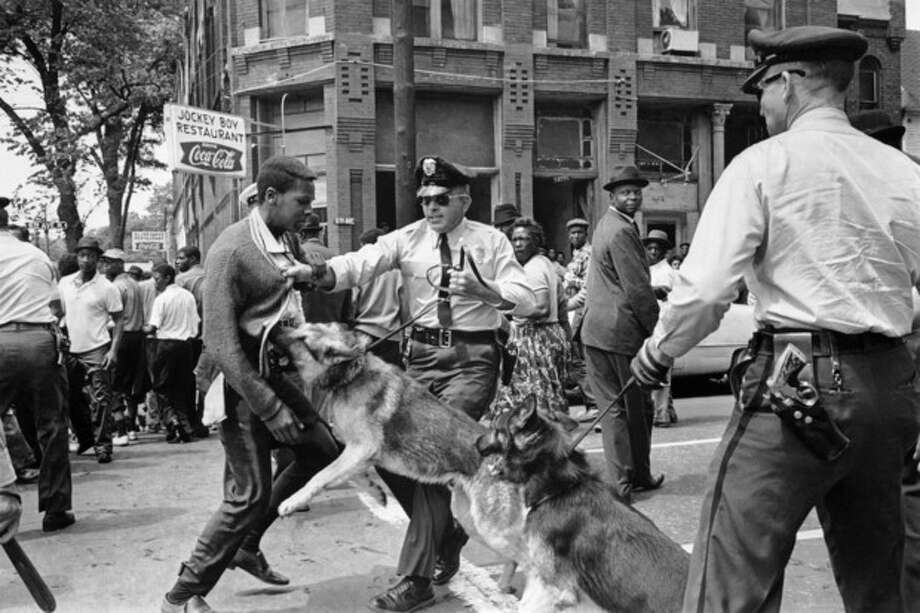 FILE - In this May 3, 1963 file photo, a 17-year-old civil rights demonstrator, defying an anti-parade ordinance of Birmingham, Ala., is attacked by a police dog. 1963 was a year of revolution in race relations in the United States. (AP Photo/Bill Hudson, File) / AP