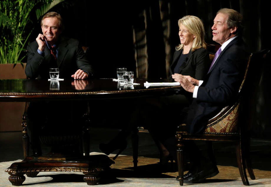 Journalist Charlie Rose, right, smiles as he interviews Robert F. Kennedy, Rory Kennedy, center, and Robert F. Kennedy Jr. in front of a full audience at the AT&T Performing Arts Center Friday, Jan. 11, 2013, in Dallas. The Kennedys are in Dallas as a year of observances begins for the 50th anniversary of President John F. Kennedy's assassination. (AP Photo/Tony Gutierrez) / AP