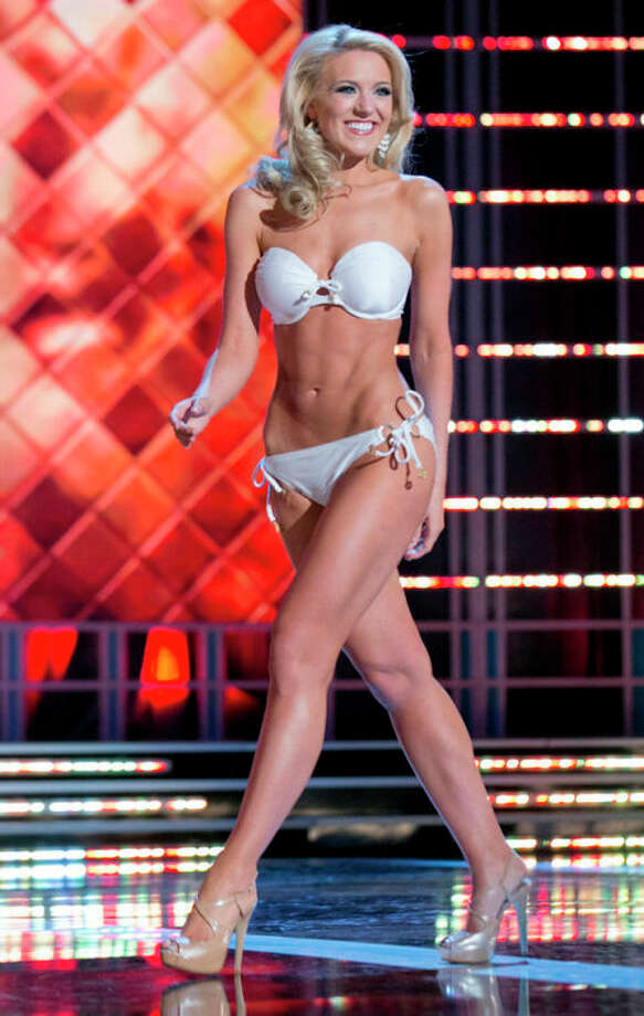 This photo courtesy Miss America Organization shows Miss Washington Mandy Schendel who took the trophy for the third round of the Lifestyle and Fitness category after modeling a strapless white Catalina swimsuit on Thursday. Jan. 10, 2013, at the Planet Hollywood casino in Las Vegas. The 22-year-old from Newcastle, Wash., earned a $1,000 Amway scholarship for it. (AP Photo/Miss America Organization) / Miss America Organization
