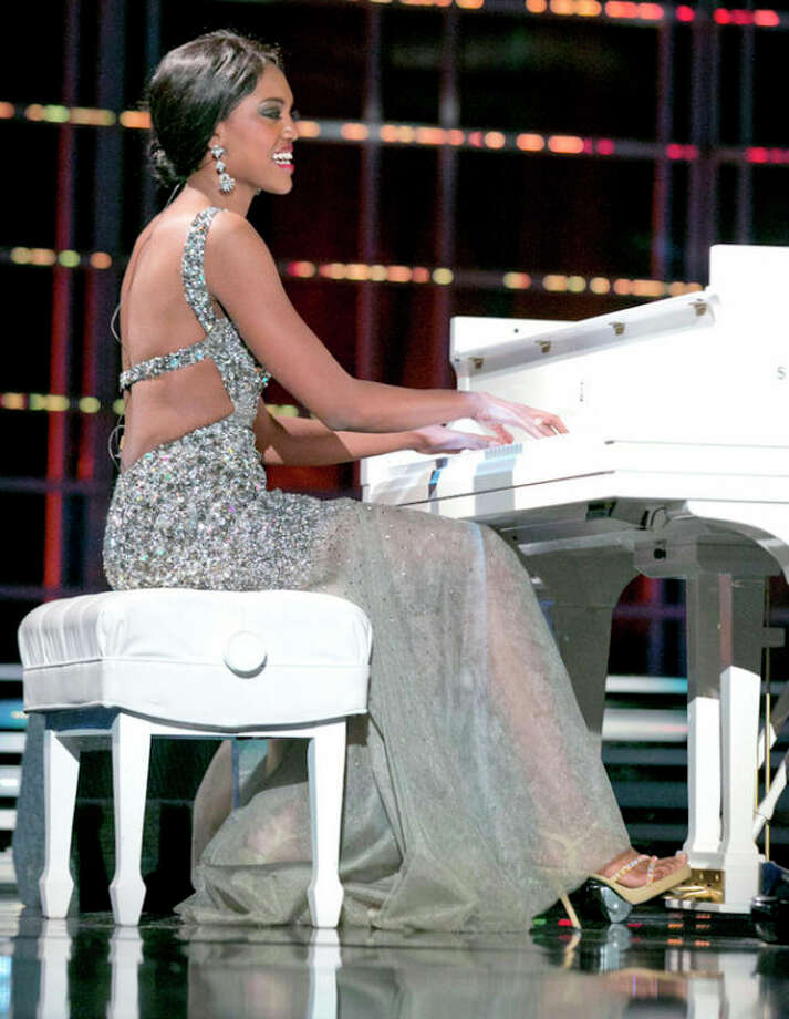 """This photo courtesy Miss America Organization shows Miss North Dakota Rosie Sauvageau took top honors Thursday, Jan. 10, 2013, after her piano and vocal rendition of """"To Make You Feel My Love."""" The 24-year-old from Fargo, N.D., will take home a $2,000 Amway scholarship from the competition at Planet Hollywood resort in Las Vegas. (AP Photo/Miss America Organization) / Miss America Organization"""