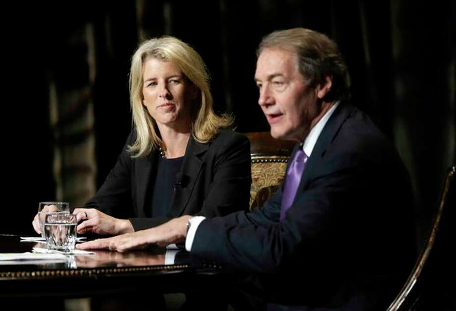 Journalist Charlie Rose, right, makes opening comments as Rory Kennedy, left, looks on during a Rose interview in front of a full audience that included her brother Robert F. Kennedy Jr., at the AT&T Performing Arts Center Friday, Jan. 11, 2013, in Dallas, Texas. The Kennedys are in Dallas as a year of observances begins for the 50th anniversary of President John F. Kennedy's assassination. (AP Photo/Tony Gutierrez) / AP