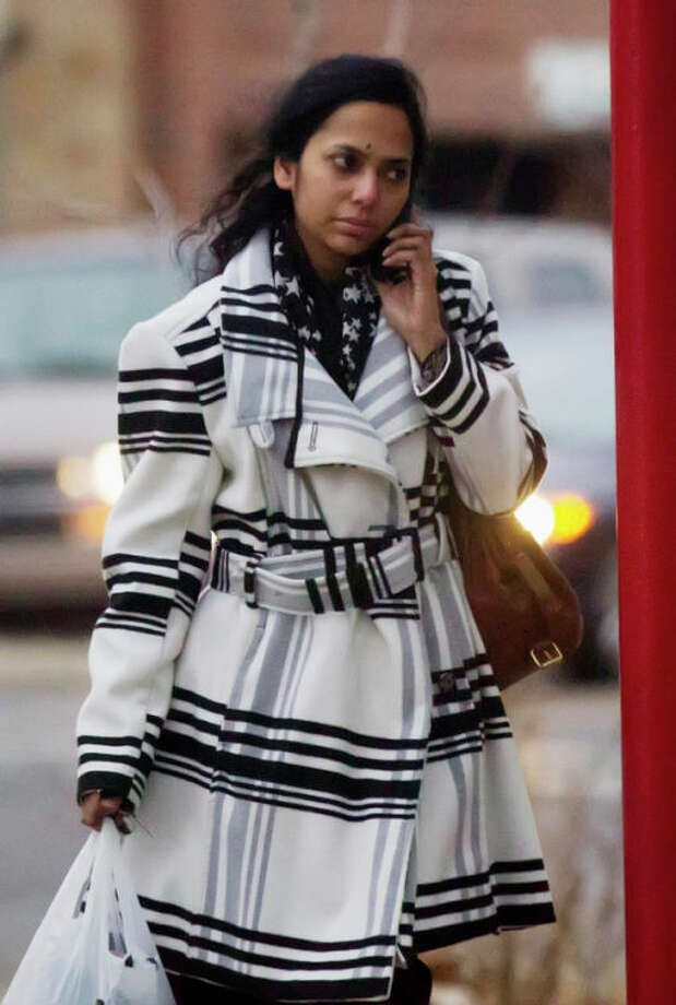 In this Thursday, Jan. 10. 2013 photo, Shabana Ansari, the wife of Urooj Khan, exits a dry cleaners in Chicago, Ill. Khan, 46, who owned several dry cleaning operations and some real estate, died suddenly on July 20, 2012, just days before he was to collect his winnings. Khan's death has been ruled a homicide. Court records show that Ansari has battled with his siblings over control of his estate, including his $425,000 prize money. A Cook County judge on Friday, Jan. 11, 2013, approved the exhumation of Khan's body. (AP Photo/Chicago Sun-Times, Andrew A. Nelles) CHICAGO LOCALS OUT, MAGS OUT / Chicago Sun-Times