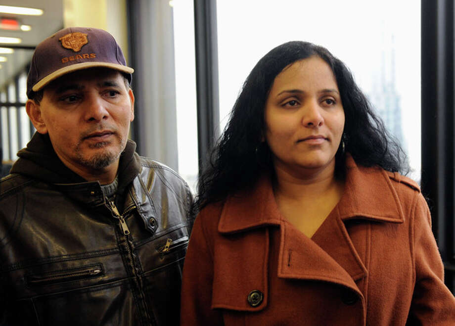 Meraj Khan, right, and Ferozo Khan, sister and brother of Illinois lottery winner Urooj Kahn, who was fatally poisoned with cyanide in July 2012 just as he was about to collect $425,000 in lottery winnings, leave a Cook County courtroom Friday, Jan. 11, 2013, after a judge granted permission to have their brother's body exhumed. Meraj said she hoped her brother would rest in peace but understands a decision to exhume his body. (AP Photo/Chicago Sun-Times, John H. White) CHICAGO LOCALS OUT, MAGS OUT / Chicago Sun-Times
