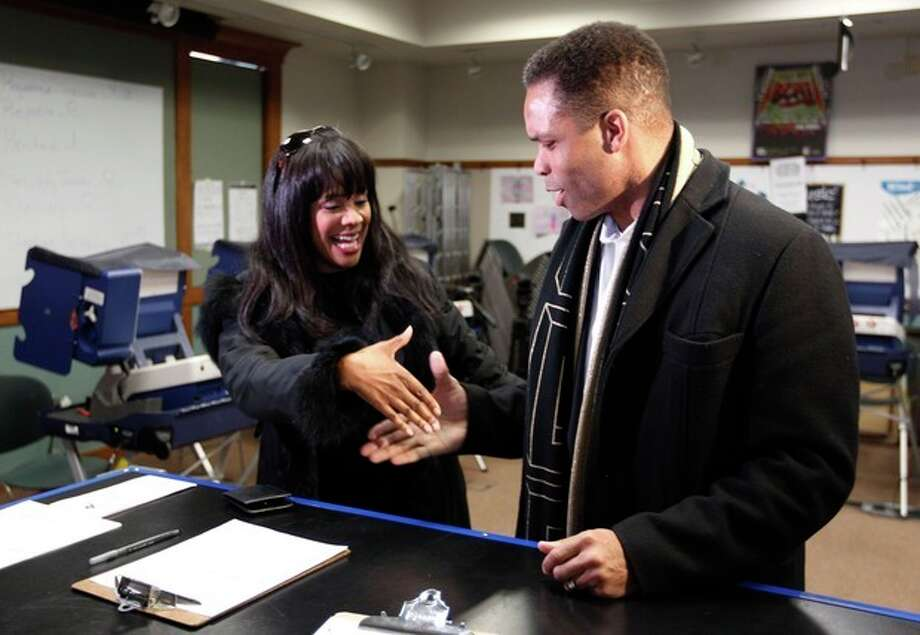 "FILE - In this March 9, 2012 file photo, then-U.S. Rep. Jesse Jackson Jr.,and his wife, Chicago Alderman Sandi Jackson, ask each other for their support and votes as they arrive at a polling station for early voting in Chicago. Alderman Sandi Jackson on Friday, Jan. 11, 2013 announced she is resigning from the Chicago City Council. In a letter to Mayor Rahm Emanuel, she said that she could not adequately represent her district ""while dealing with very painful family health matters."" Rep. Jackson recently resigned from Congress while being treated for bipolar disorder and other medical issues. (AP Photo/M. Spencer Green, File) / AP"