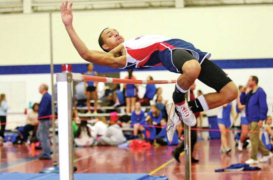 Hour photo/Erik TrautmannBrien McMahon's Evan Collins competes in the high jump during the FCIAC indoor track meet at Staples High School in Westport on Saturday. / (C)2012, The Hour Newspapers, all rights reserved