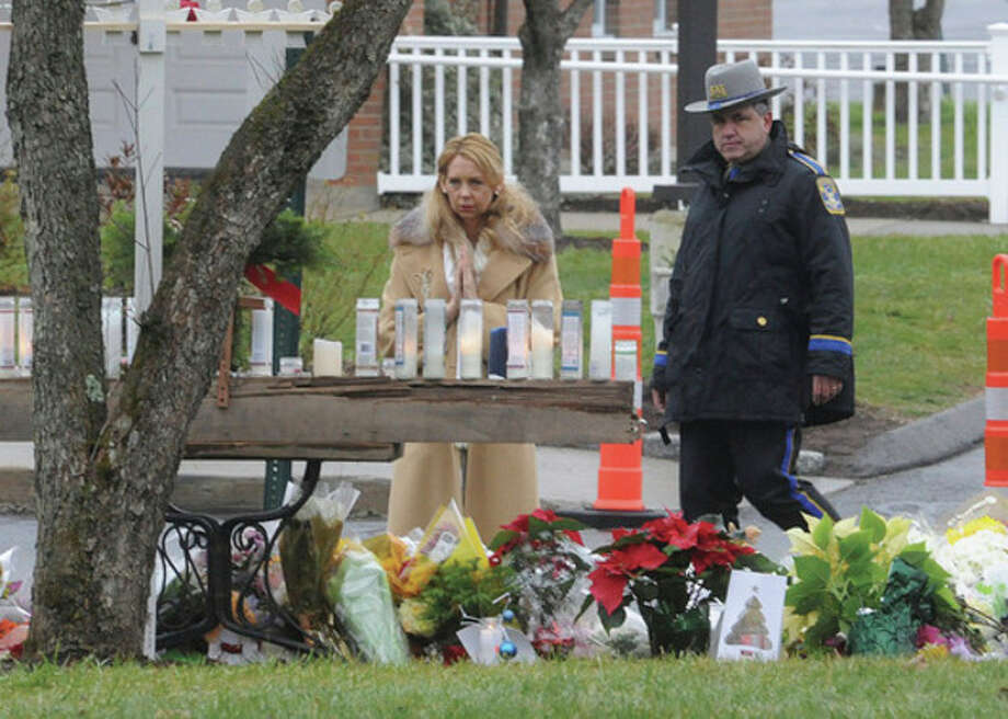 A mourners pays respects Sunday at Saint Rose of Lima church in Newtown, one of the many services for the victims of Sandy Hook Elementary school. hour photo/Matthew Vinci / (C)2011 {your name}, all rights reserved
