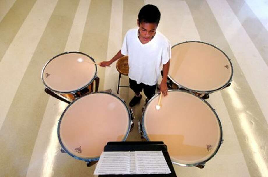 Photo/Alex von Kleydorff. 14 yr old Imani Montgomery works on some rally songs on the Tympani drums during band camp at Brien McMahon High School