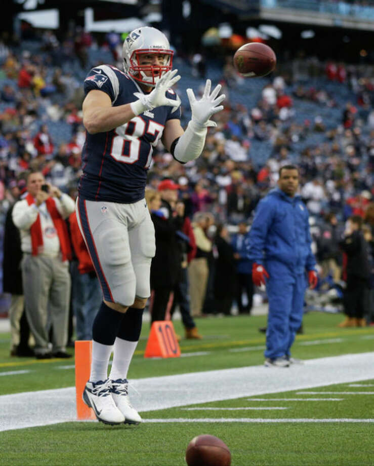 New England Patriots tight end Rob Gronkowski warms up before an AFC divisional playoff NFL football game against the Houston Texans in Foxborough, Mass., Sunday, Jan. 13, 2013. Gronkowski went to the locker room with an arm injury midway through the first quarter, and did not return. (AP Photo/Elise Amendola) / AP