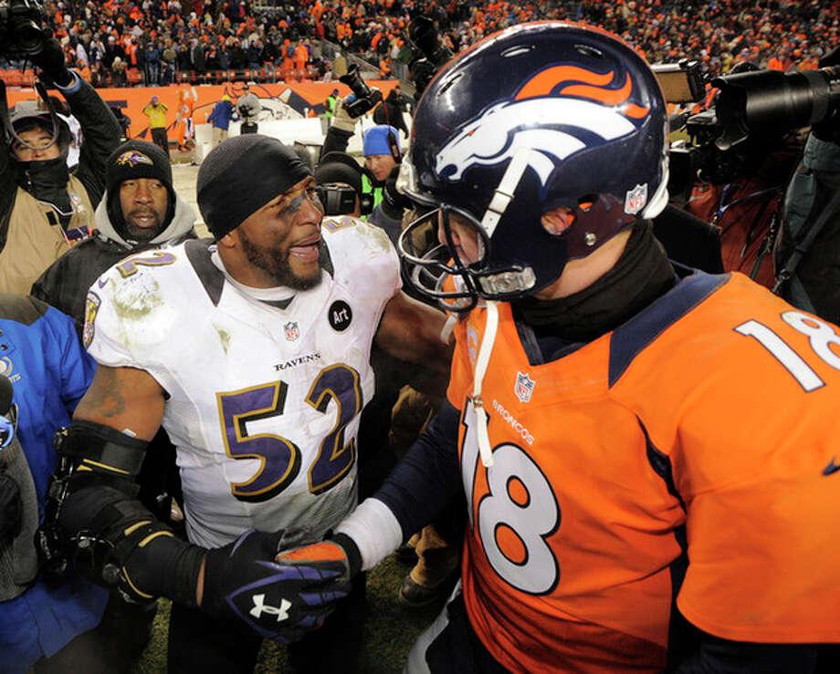 Baltimore Ravens inside linebacker Ray Lewis shakes hands Denver Broncos quarterback Peyton Manning (18) after the Ravens won 38-35 in overtime of an AFC divisional playoff NFL football game, Saturday, Jan. 12, 2013, in Denver. (AP Photo/Jack Dempsey) / FR42408 AP