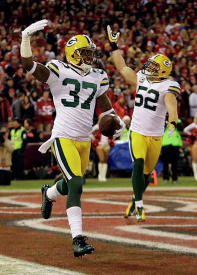 Green Bay Packers cornerback Sam Shields (37) celebrates with outside linebacker Clay Matthews (52) after returning an interception from San Francisco 49ers quarterback Colin Kaepernick for a touchdown during the first quarter of an NFC divisional playoff NFL football game in San Francisco, Saturday, Jan. 12, 2013. (AP Photo/Ben Margot) / AP