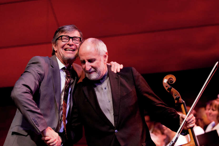 """Darius Brubeck embraces Eugene Friesen after their performance of """"Take Five"""" at the Community Celebration of the Life and Music of Dave Brubeck at Wilton High School on Saturday, January 12, 2013. (Chris Palermo / Hour Photo) / ©2012 The Hour Newspapers All Rights Reserved"""