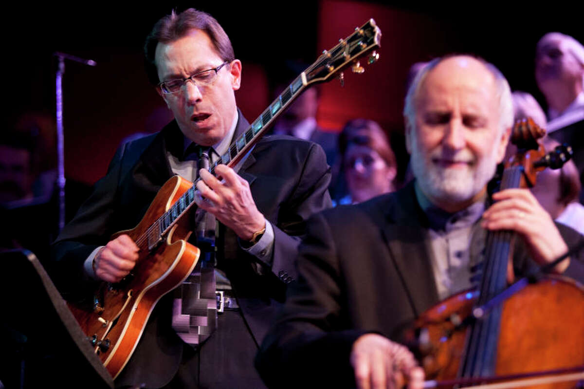 """Mike DeMicco performs """"Take Five"""" with Eugene Friesen on cello at the Community Celebration of the Life and Music of Dave Brubeck at Wilton High School on Saturday, January 12, 2013. (Chris Palermo / Hour Photo)"""