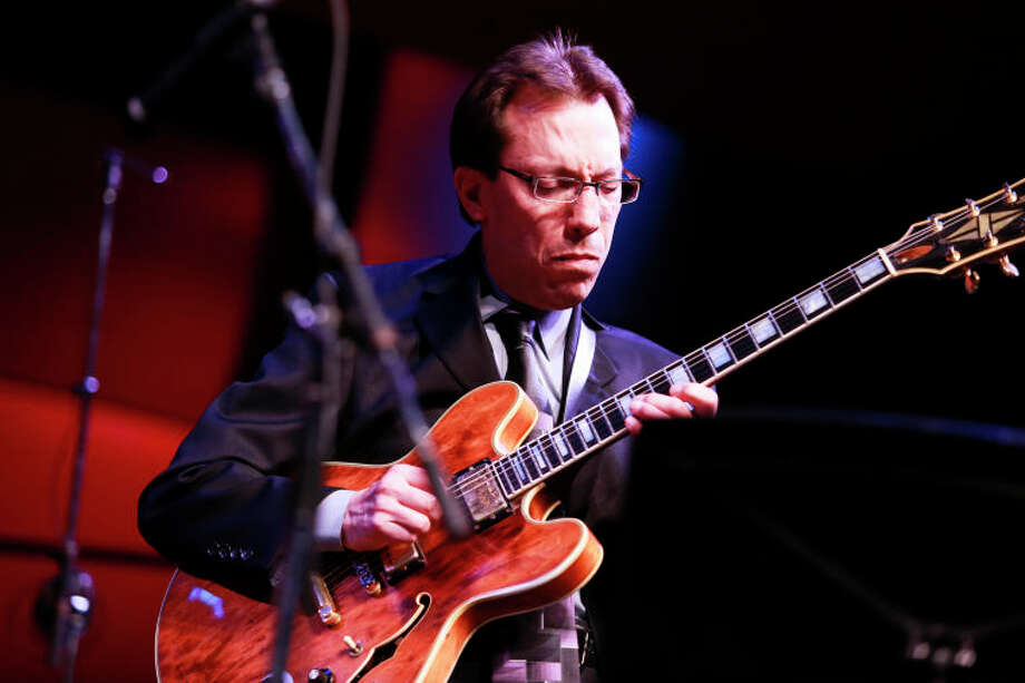Mike DeMicco performs on guitar during the Dave Brubeck Celebration at Wilton High School on Saturday night. (Chris Palermo / Hour Photo) / ©2012 The Hour Newspapers All Rights Reserved