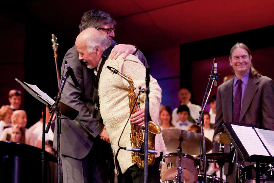 Darius Brubeck hugs Paul Winter as Dan Brubeck looks on after the Community Celebration of the Life and Music of Dave Brubeck at Wilton High School on Saturday, January 12, 2013. (Chris Palermo / Hour Photo) / ©2012 The Hour Newspapers All Rights Reserved