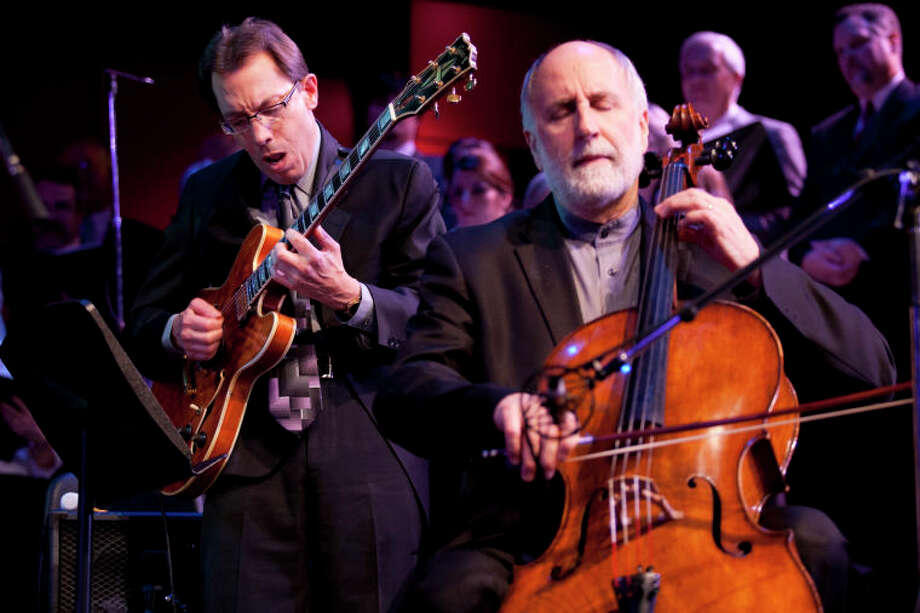 "Mike DeMicco performs ""Take Five"" with Eugene Friesen on cello at the Community Celebration of the Life and Music of Dave Brubeck at Wilton High School on Saturday, January 12, 2013. (Chris Palermo / Hour Photo) / ©2012 The Hour Newspapers All Rights Reserved"