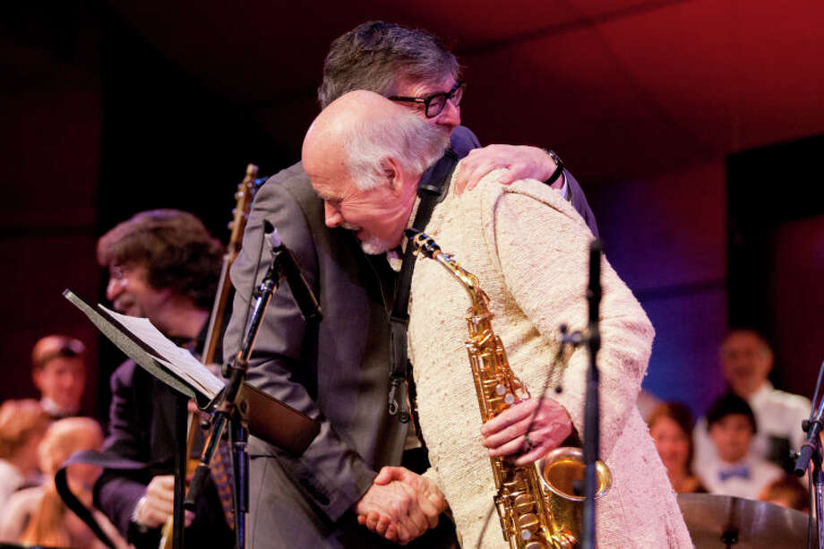 Darius Brubeck hugs Paul Winter after their performance during the Community Celebration of the Life and Music of Dave Brubeck at Wilton High School on Saturday, January 12, 2013. (Chris Palermo / Hour Photo) / ©2012 The Hour Newspapers All Rights Reserved