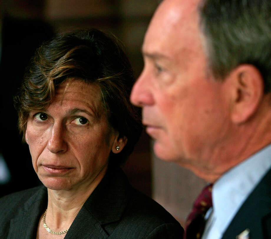 FILE - In this Wednesday, March 25, 2009 file photo, Randi Weingarten, president of the American Federation of Teachers, left, listens as New York Mayor Michael Bloomberg speaks during a news conference at the Capitol in Albany, N.Y. The clock is ticking for New York City and the union representing 75,000 public school teachers to agree on a system for evaluating teachers or risk losing $450 million in state aid and grants. With a Thursday, Jan. 17, 2013 deadline looming, negotiations on the evaluation plan resumed during the previous week for the first time since mid-December. (AP Photo/Mike Groll, File) / AP