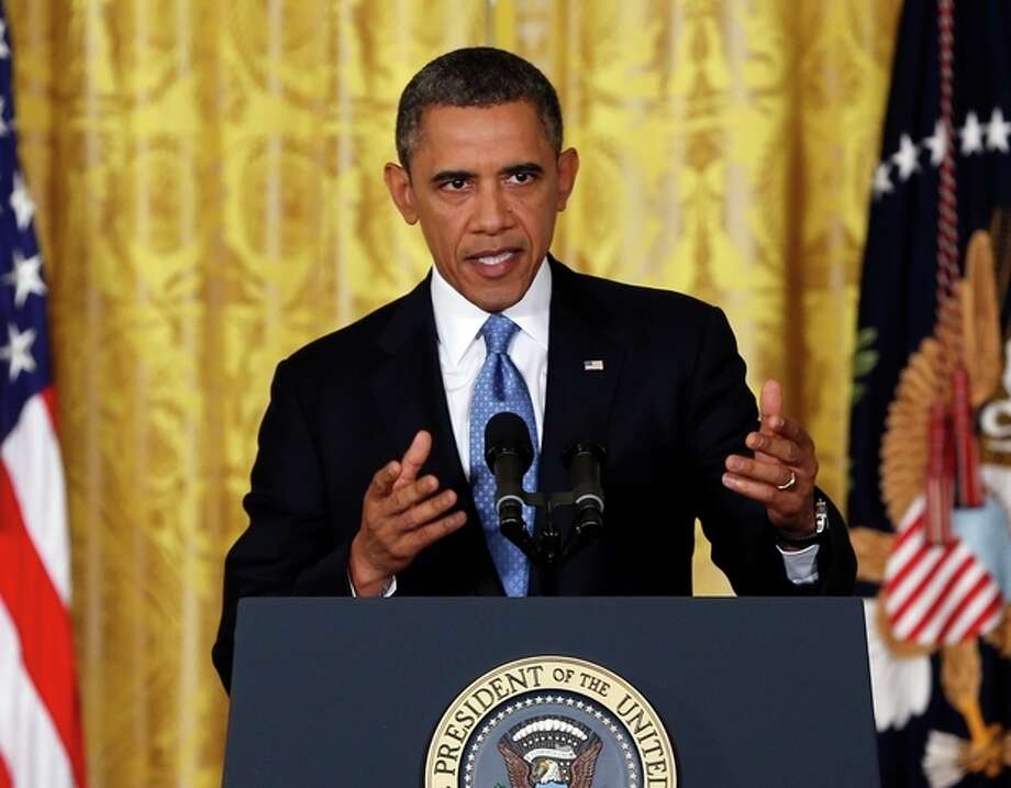 AP Photo/Carolyn KasterPresident Barack Obama speaks about the debt limit in the East Room of the White House in Washington, Monday. / AP