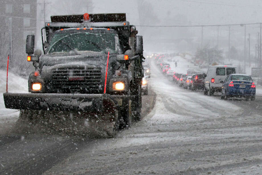 A snowplow scrapes route 144, Peppers Ferry Blvd near New River Valley Mall in Christiansburg, Via. Thursday Jan. 17, 2013. A winter storm was making its way across the Southeast on Thursday, dumping 4 inches of snow in Mississippi and playing a role in a traffic fatality there, with the system expected to spread across northern Georgia and into the Washington, D.C., area, according to the National Weather Service. (AP Photo/The Roanoke Times, Matt Gentry) LOCAL TV OUT; SALEM TIMES REGISTER OUT; FINCASTLE HERALD OUT; CHRISTIANBURG NEWS MESSENGER OUT; RADFORD NEWS JOURNAL OUT; ROANOKE STAR SENTINEL OUT / The Roanoke Times