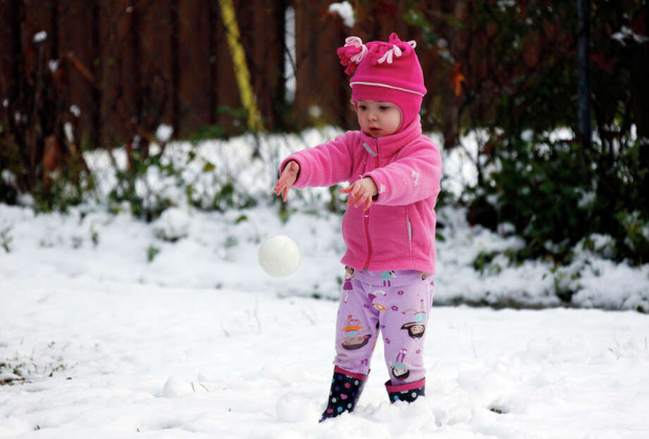 Molly Cleland, two and a half, throws her own foam ball in favor to a snowball while playing in the snow in Jackson, Miss., Thursday, Jan. 17, 2013. A winter storm system left 2 to 4 inches of snow in parts of central Mississippi before heading east toward Alabama, the National Weather Service said. (AP Photo/Rogelio V. Solis) / AP