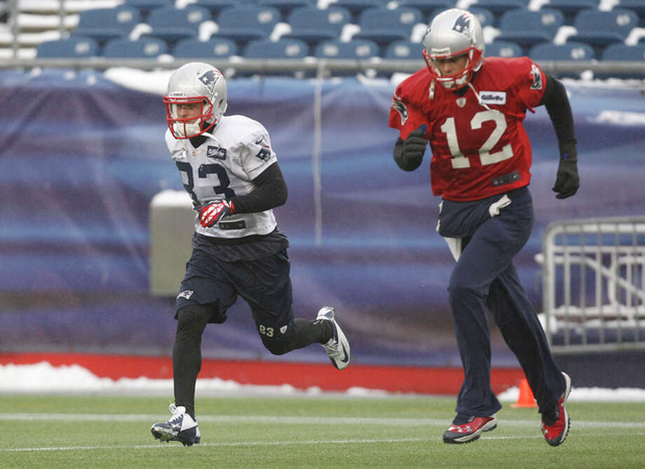 New England Patriots wide receiver Wes Welker (83) and quarterback Tom Brady run during practice at the NFL football team's facility in Foxborough, Mass., Wednesday, Jan. 16, 2013. The Patriots will play the Baltimore Ravens in the AFC Championship game for the second year in a row at Foxborough this Sunday. (AP Photo/Stephan Savoia) / AP