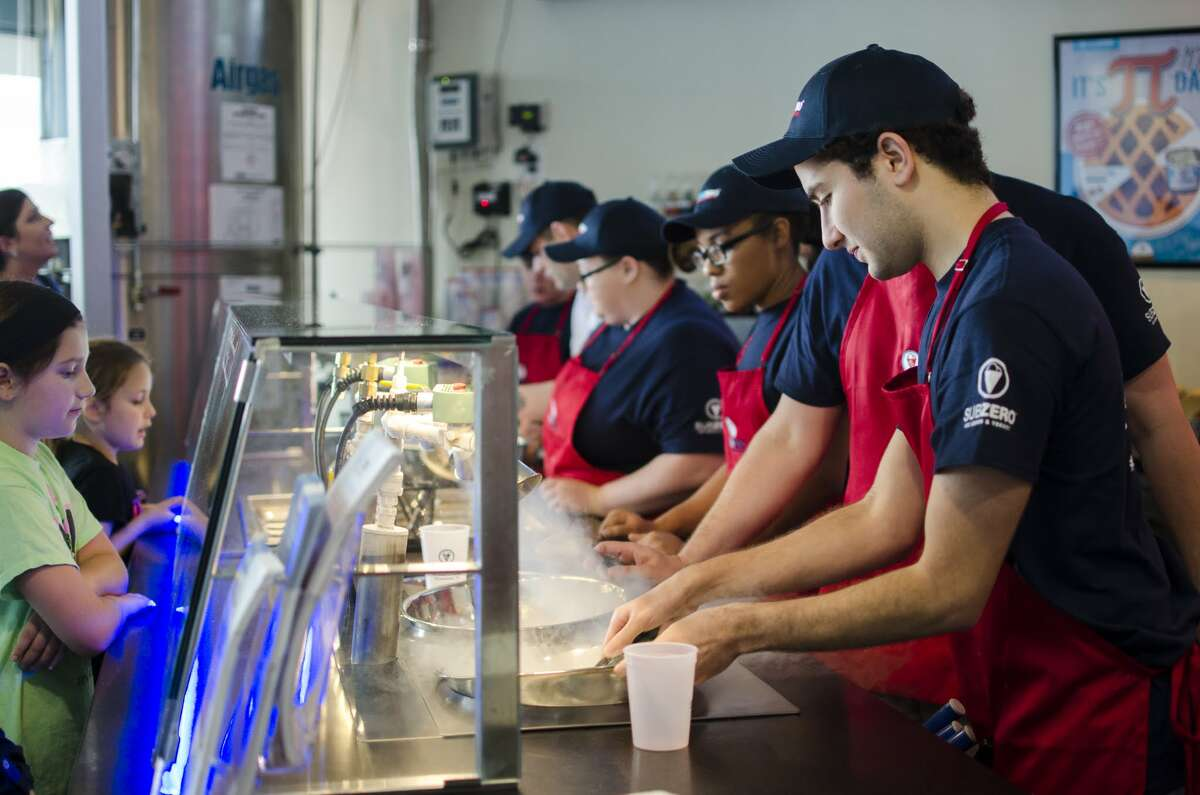 Sub Zero ice Cream will open June 17 at 15810 Southwest Fwy. in Sugar Land. The ice cream is made to order using liquid nitrogen. Shown: Workers preparing ice cream for customers.