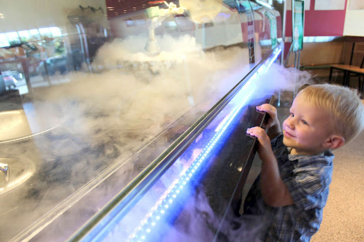 Sub Zero ice Cream will open June 17 at 15810 Southwest Fwy. in Sugar Land. The ice cream is made to order using liquid nitrogen. Shown: A child watching the ice cream making process.