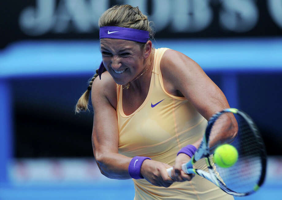 Victoria Azarenka of Belarus makes a backhand return to Greece's Eleni Daniilidou during their second round match at the Australian Open tennis championship in Melbourne, Australia, Thursday, Jan. 17, 2013. (AP Photo/Andrew Brownbill) / AP