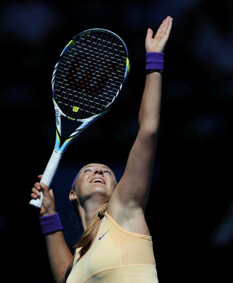 Victoria Azarenka of Belarus serves to Greece's Eleni Daniilidou during their second round match at the Australian Open tennis championship in Melbourne, Australia, Thursday, Jan. 17, 2013. (AP Photo/Andrew Brownbill) / AP