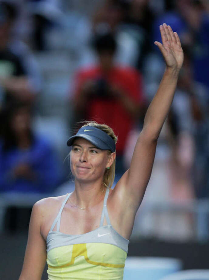 Russia's Maria Sharapova waves to the crowd after defeating Japan's Misaki Doi during their second round match at the Australian Open tennis championship in Melbourne, Australia, Wednesday, Jan. 16, 2013. (AP Photo/Rob Griffith) / AP