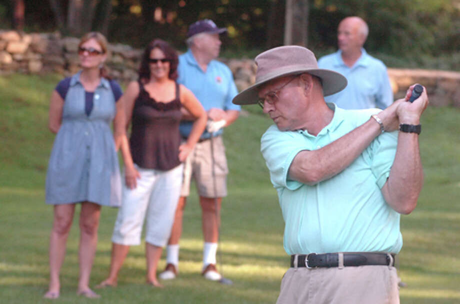 Hour Photo/Alex von Kleydorff. Jim Casagrande tees off on the 15th hole during the Senators Gridiron Classic at Oak Hills / 2011 The Hour Newspapers