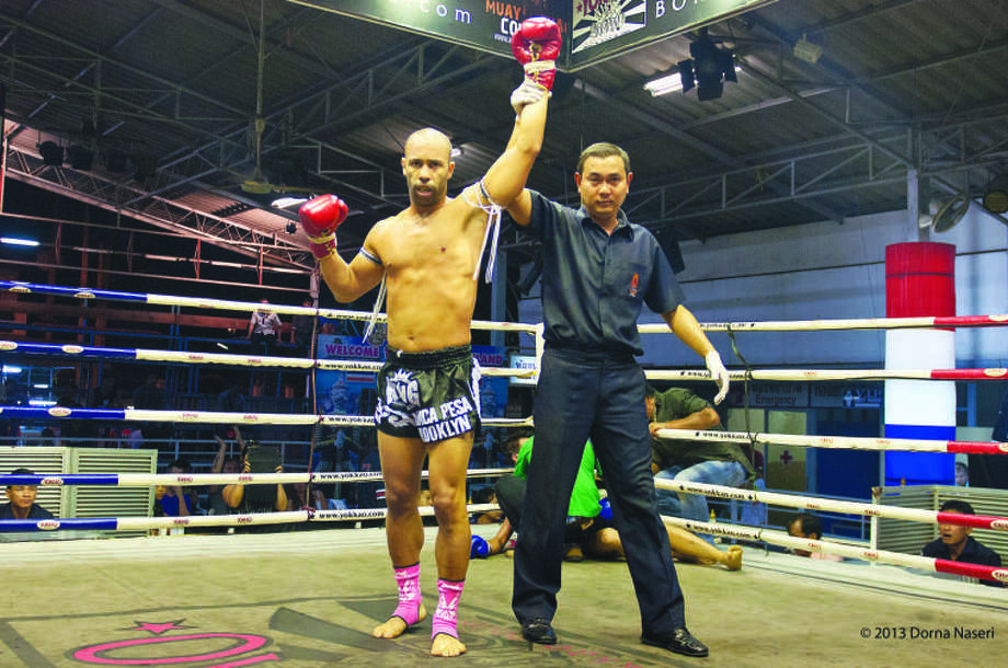 Banker turned fighter retries with win