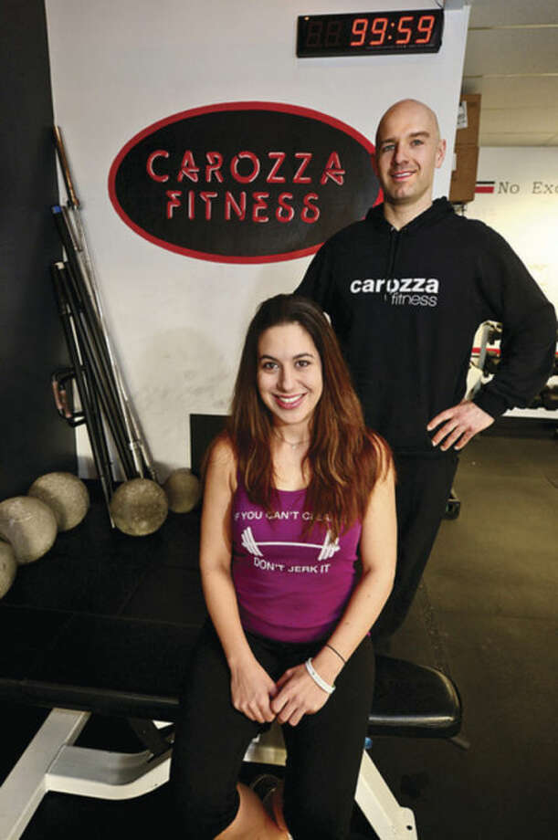 Carozza Fitness owner Michael Carozza and member Lexi Forrest, who is cousin to one of the Sandy Hook victims. Carozza Fitness will be host a team fitness competition to help raise money for the Sandy Hook Elementary School Fund.Hour photo / Erik Trautmann