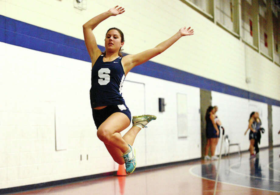 Staples' Amanda Giannitti competes in the girls long jump during the FCIAC indoor track meet at Staples High School in Westport.Hour photo / Erik Trautmann / (C)2012, The Hour Newspapers, all rights reserved