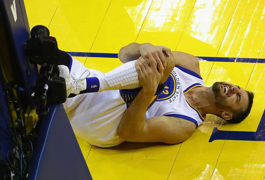 OAKLAND, CA - JUNE 13:  Andrew Bogut #12 of the Golden State Warriors reacts after suffering an apparent injury during the second half against the Cleveland Cavaliers in Game 5 of the 2016 NBA Finals at ORACLE Arena on June 13, 2016 in Oakland, California. NOTE TO USER: User expressly acknowledges and agrees that, by downloading and or using this photograph, User is consenting to the terms and conditions of the Getty Images License Agreement.  (Photo by Ezra Shaw/Getty Images) Photo: Ezra Shaw, Getty Images