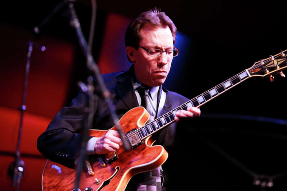 Mike DeMicco performs on guitar during the Dave Brubeck Celebration at Wilton High School on Saturday night. (Chris Palermo / Hour Photo) / 2013 Chris Palermo