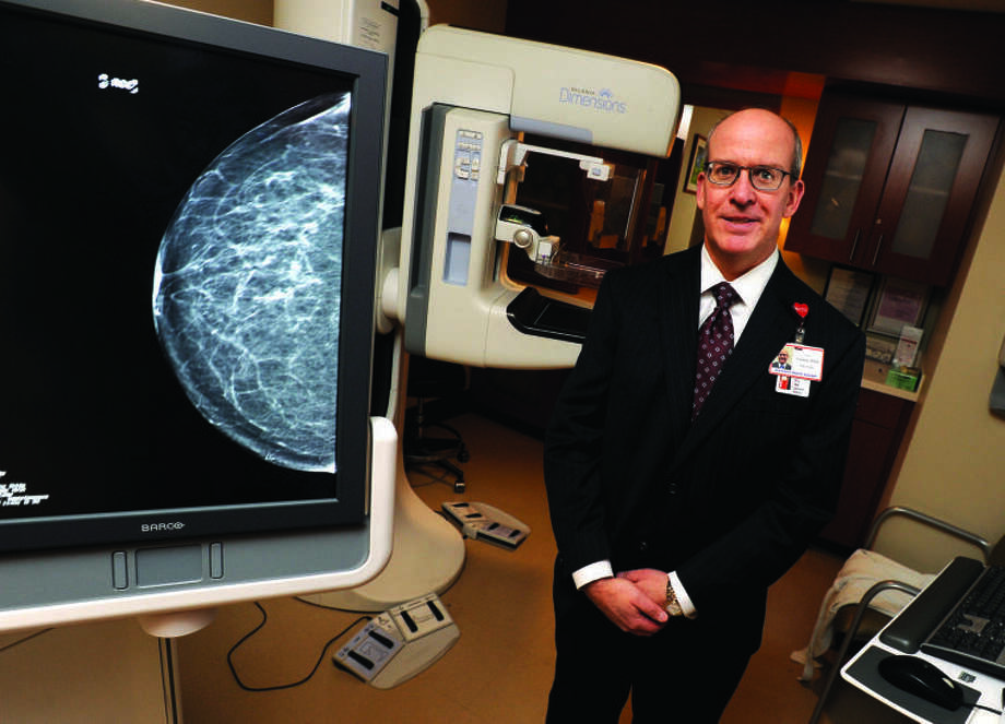 Dr. David R. Gruen, director of women's imaging at Stamford Hospital, stands with the only 3D mammography screening technology in the area.