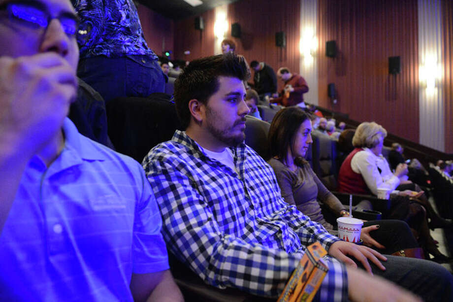 Guests wait in their seats for the reopening and remembrance ceremony at the Century Aurora cinema, formerly the Century 16, Thursday, Jan. 17, 2013 in Aurora, Colo. The cinema is where 12 people were killed and dozens injured in a shooting rampage last July. (AP Photo/The Denver Post, RJ Sangosti, Pool) / Pool Denver Post