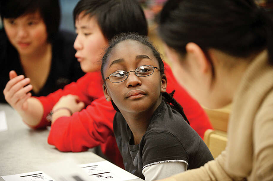 Brien McMahon High School Center for Global Studies students teach Chinese and Chinese culture to Brookside students including 5th grader Hazell Robinson Friday. Hour photo / Erik Trautmann / (C)2012, The Hour Newspapers, all rights reserved