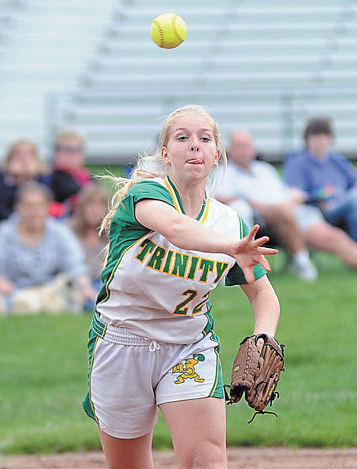 Hour Photo/John Nash - Trinity Catholic third baseman and Norwalk resident Caitlin Ornousky comes up firing to first aftr fielding a ground ball vs. Wilton.