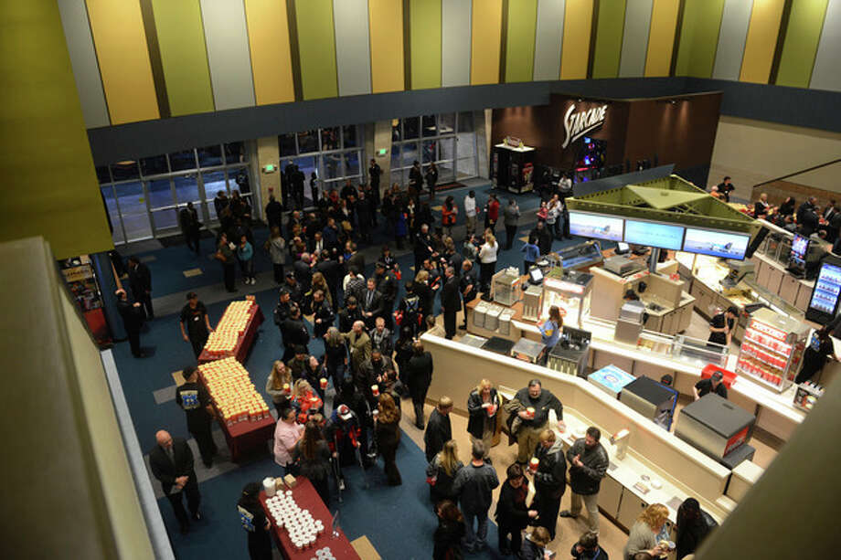 Guests fill the lobby of the Century Aurora cinema, formerly the Century 16, for a reopening and remembrance ceremony Thursday, Jan. 17, 2013 in Aurora, Colo. The theater is where 12 people were killed and dozens injured in a shooting rampage last July. (AP Photo/The Denver Post, RJ Sangosti, Pool) / Pool Denver Post