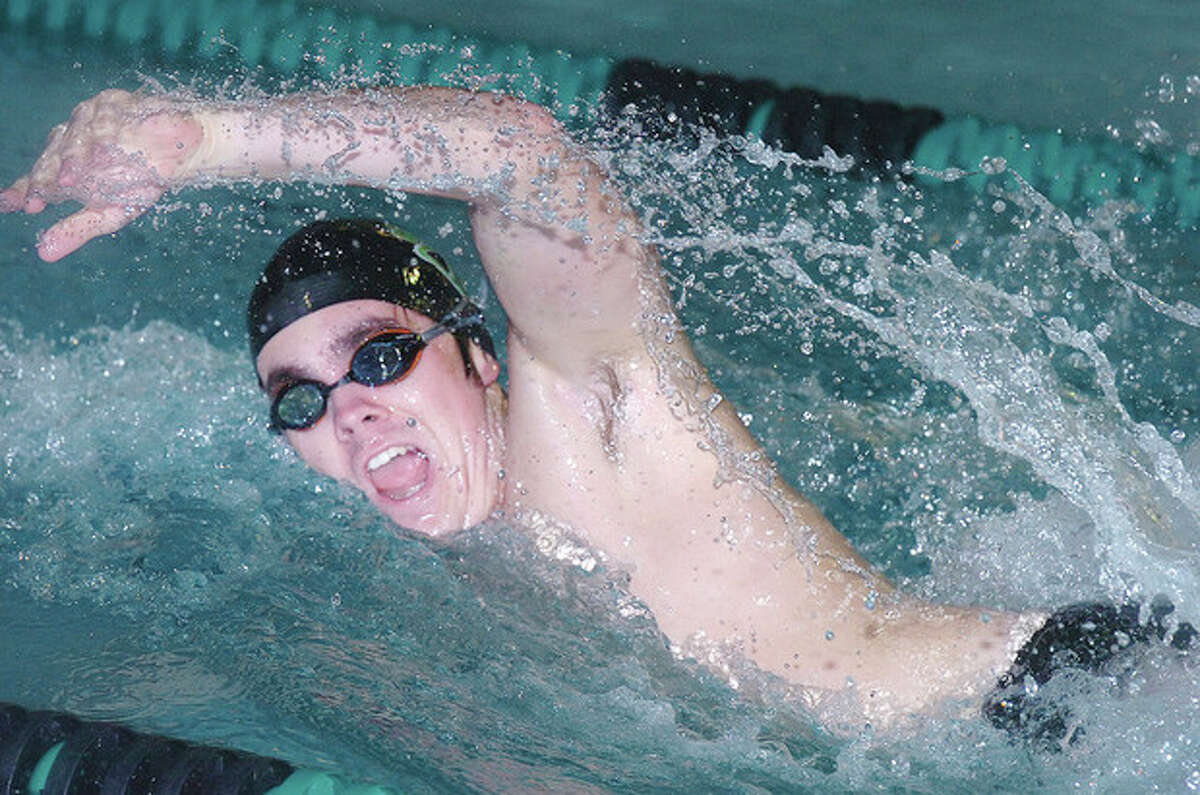 Hour Photo Alex von Kleydorff Jake St John of the Norwalk-McMahon co-op swim team competes in the 100 freestyle during Friday's meet against Danbury at the Pat Spinola Natatorium at NHS. St. John won the event, and the Norwalk squad scored a 90-75 victory over the Hatters.
