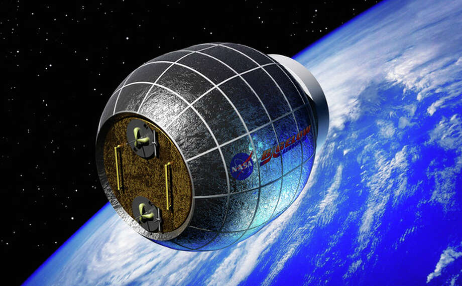 This artist's rendering provided by Bigelow Aerospace shows a Bigelow inflatable space station. NASA is partnering with this commercial space company to test an inflatable room that can be compressed into a 7-foot tube for delivery to the International Space Station. NASA is expected to install the module by 2015. (AP Photo/Bigelow Aerospace) / Bigelow Aerospace