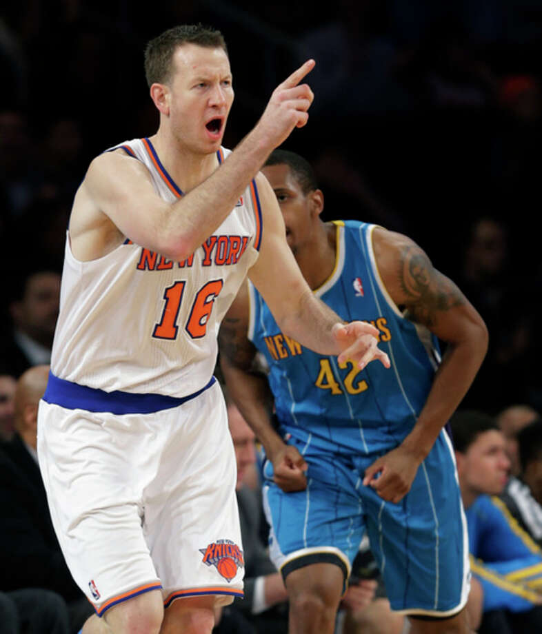 New York Knicks forward Steve Novak (16) reacts in front of New Orleans Hornets forward Lance Thomas (42) after hitting a three-point basket in the second half of the Knicks' 100-87 victory in an NBA basketball game at Madison Square Garden in New York, Sunday, Jan. 13, 2013. (AP Photo/Kathy Willens) / AP