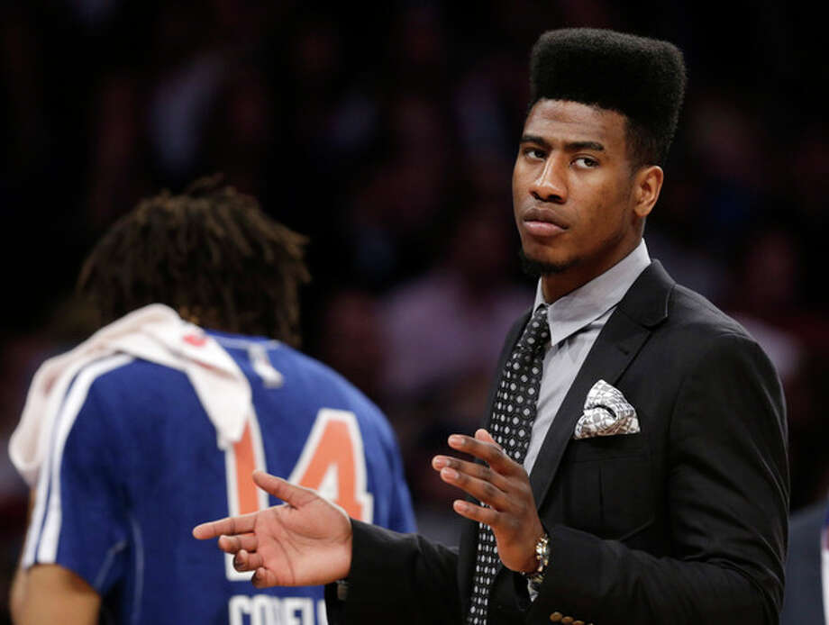 New York Knicks guard Iman Shumpert, who had offseason surgery to correct a torn left ACL, applauds as the Knicks defeated the New Orleans Hornets in an NBA basketball game at Madison Square Garden in New York, Sunday, Jan. 13, 2013. (AP Photo/Kathy Willens) / AP
