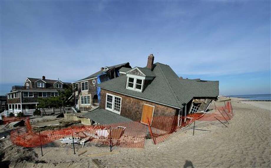 This Jan. 3, 2013 photo shows a beach front home that was severely damaged by Superstorm Sandy resting in the sand in Bay Head, N.J., Thursday, Jan. 3, 2013. House conservatives opposed to more deficit spending chip away at a $50.7 billion Superstorm Sandy aid package by seeking spending cuts in other programs to pay for recovery efforts and stripping money for projects they say are unrelated to the Oct. 29 storm. (AP Photo/Mel Evans) / AP