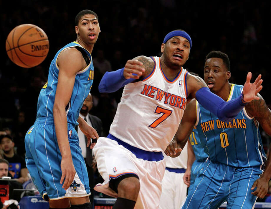 New Orleans Hornets forward Anthony Davis, left, watches as New York Knicks forward Carmelo Anthony (7) loses the ball in the first half of their NBA basketball game at Madison Square Garden in New York, Sunday, Jan. 13, 2013. Hornets forward Al-Farouq Aminu (0) looks on. (AP Photo/Kathy Willens) / AP