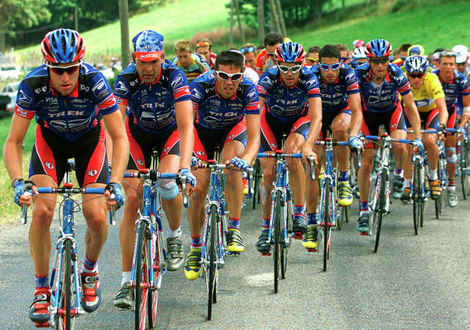 FILE - In this July 15, 1999, file photo, the U.S. Postal Service team including, from left, Christian Vandevelde, Peter Meinert-Nielsen, of Denmark, Pascal Derame, of France, Kevin Livingstone, George Hincapie, Frankie Andreu, Lance Armstrong and Tyler Hamilton, controls the pack during the 11th stage of the Tour de France cycling race between Le Bourg D'Oisans and Saint-Etienne, central France. Armstrong won his first Tour de France title in 1999_but in 2012 Armstrong was stripped of his seven Tour de France titles and banned for life by cycling's governing body. (AP Photo/Laurent Rebours, File) / AP